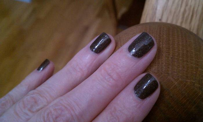 "Got the claws trimmed! Wonderful iron grey polish with iridescent sparkles.  Probably not ""brand"" at work, but I'll keep a low profile and wear gloves coming in and out of the lobby."